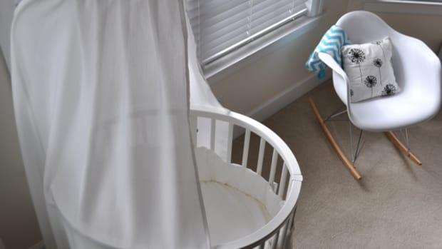 stokke sleepi and white modern rocking chair