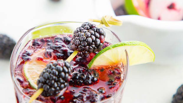 Blackberry Fizz cocktail with mortal and pestle