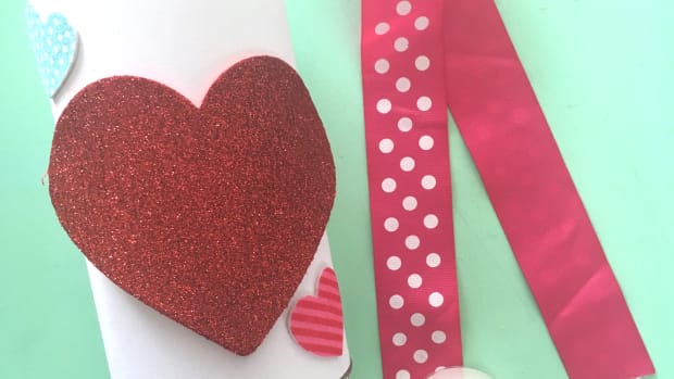 We are making these Cupid's Arrow Valentines for our kids to pass out to their friends. We even made a quiver to hold all the arrows. Make them too!