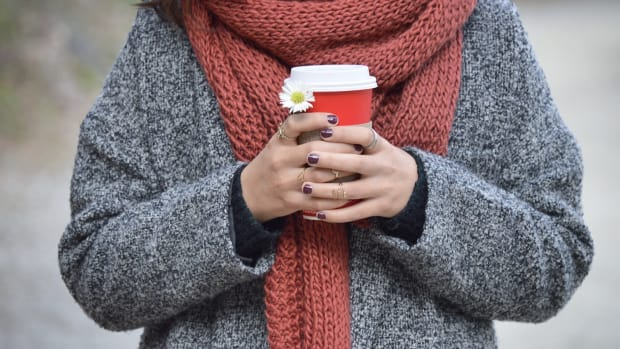 Canva - Woman Holding a Cup of Coffee