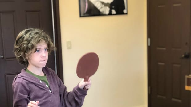 child ping pong player