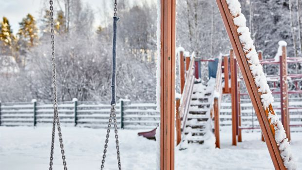 snowy playgound tire swing