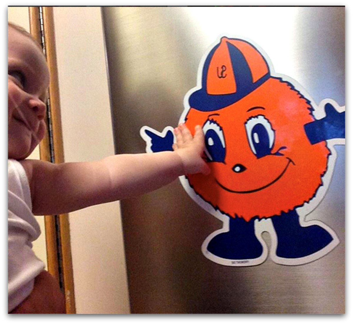 "Baby P looks lovingly at our ""Orange Man,"" Syracuse University's mascot."
