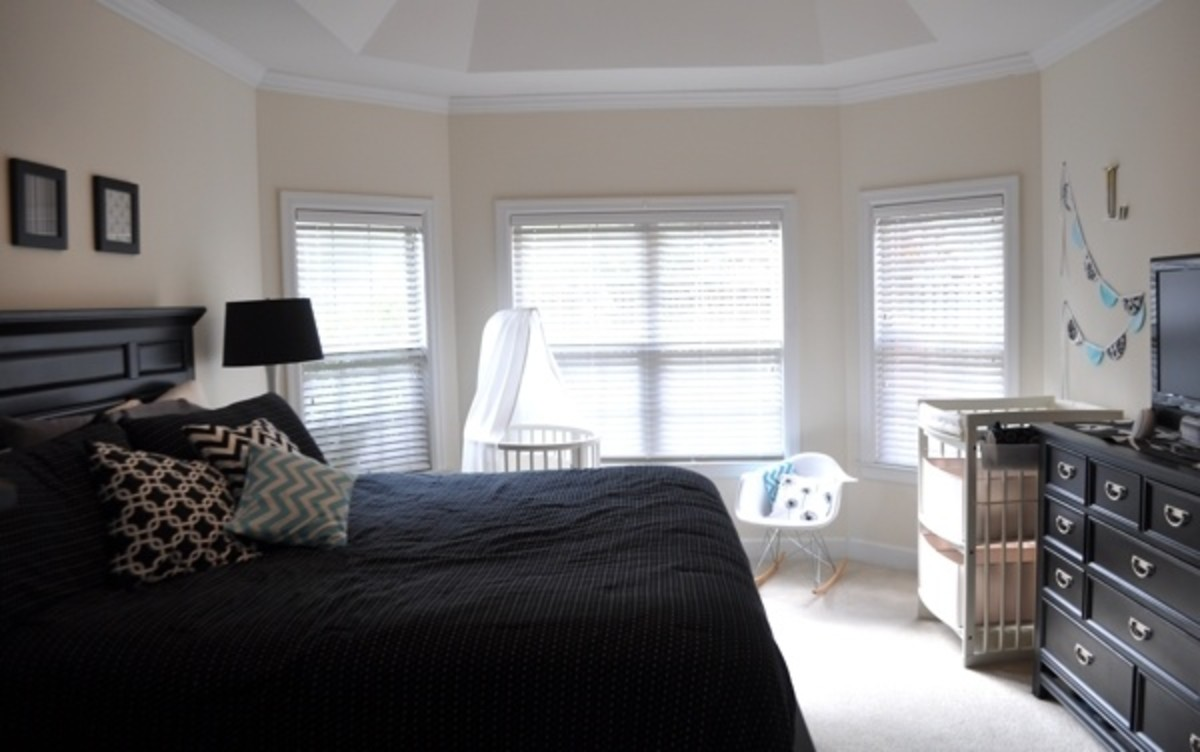 modern black and white master bedroom with stokke nursery furniture