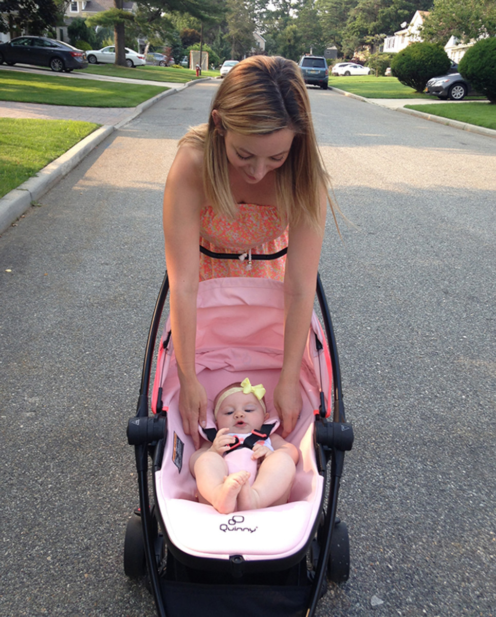 mom adjusting baby stroller