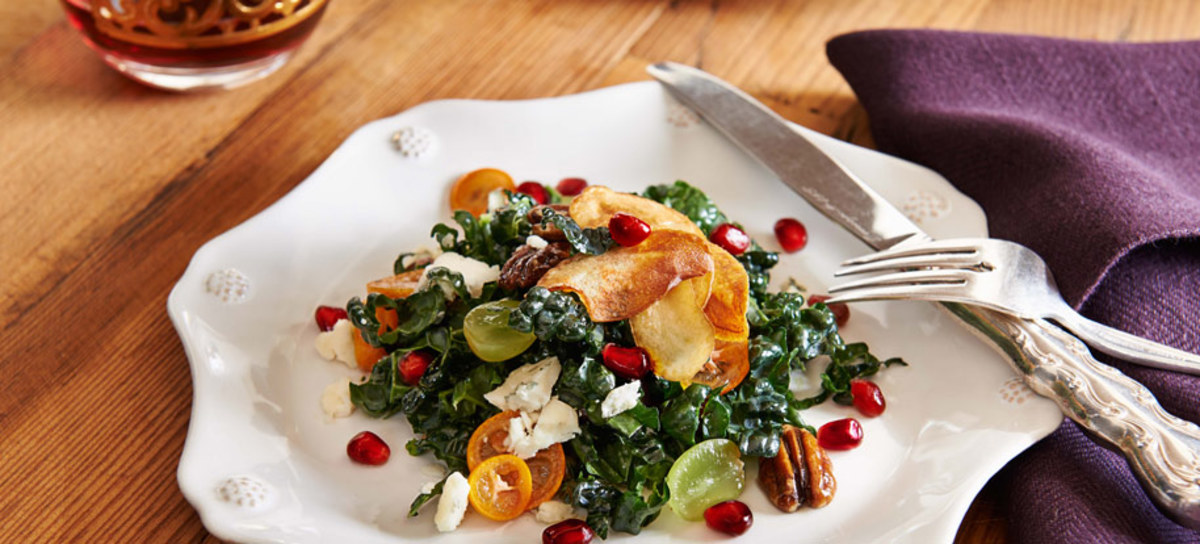 Kale Salad with Candied Pecans, Pickled Kumquat, Pomegranate Arils and Macerated Golden Grapes