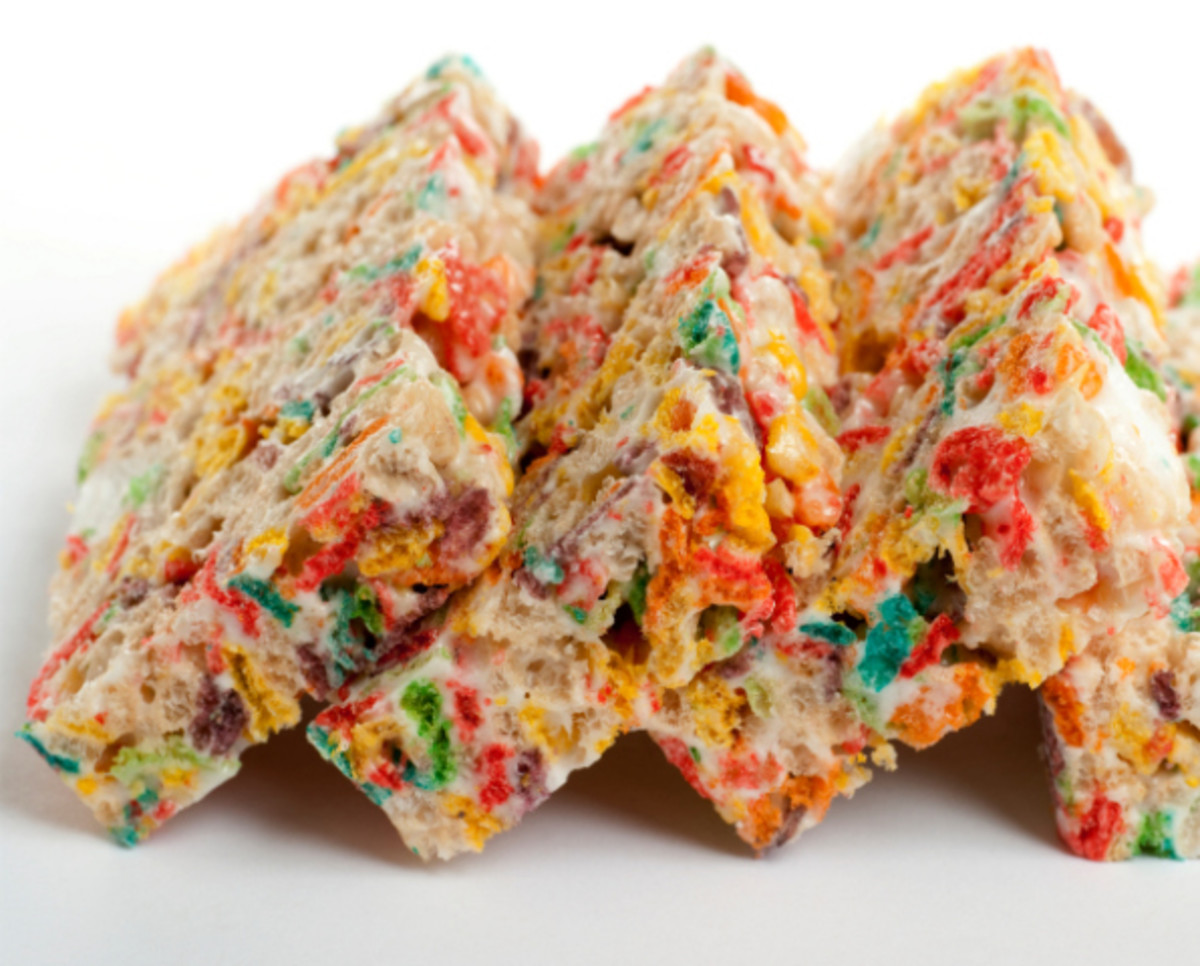 row of colorful marshmallow crispy bars on white background