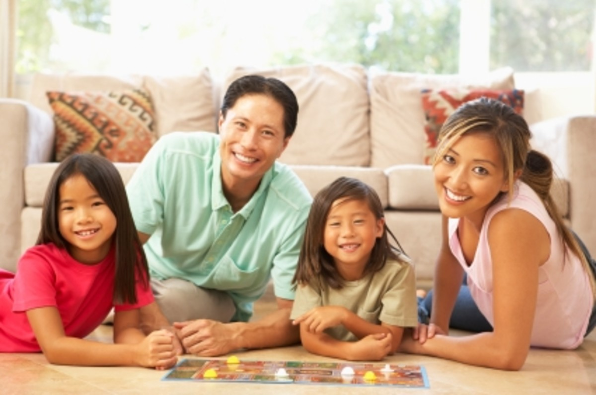 Family-Playing-Board-Game-At-Home