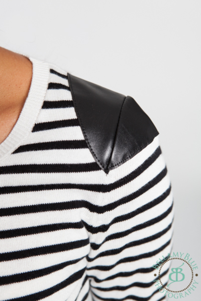 leather detail on shoulder
