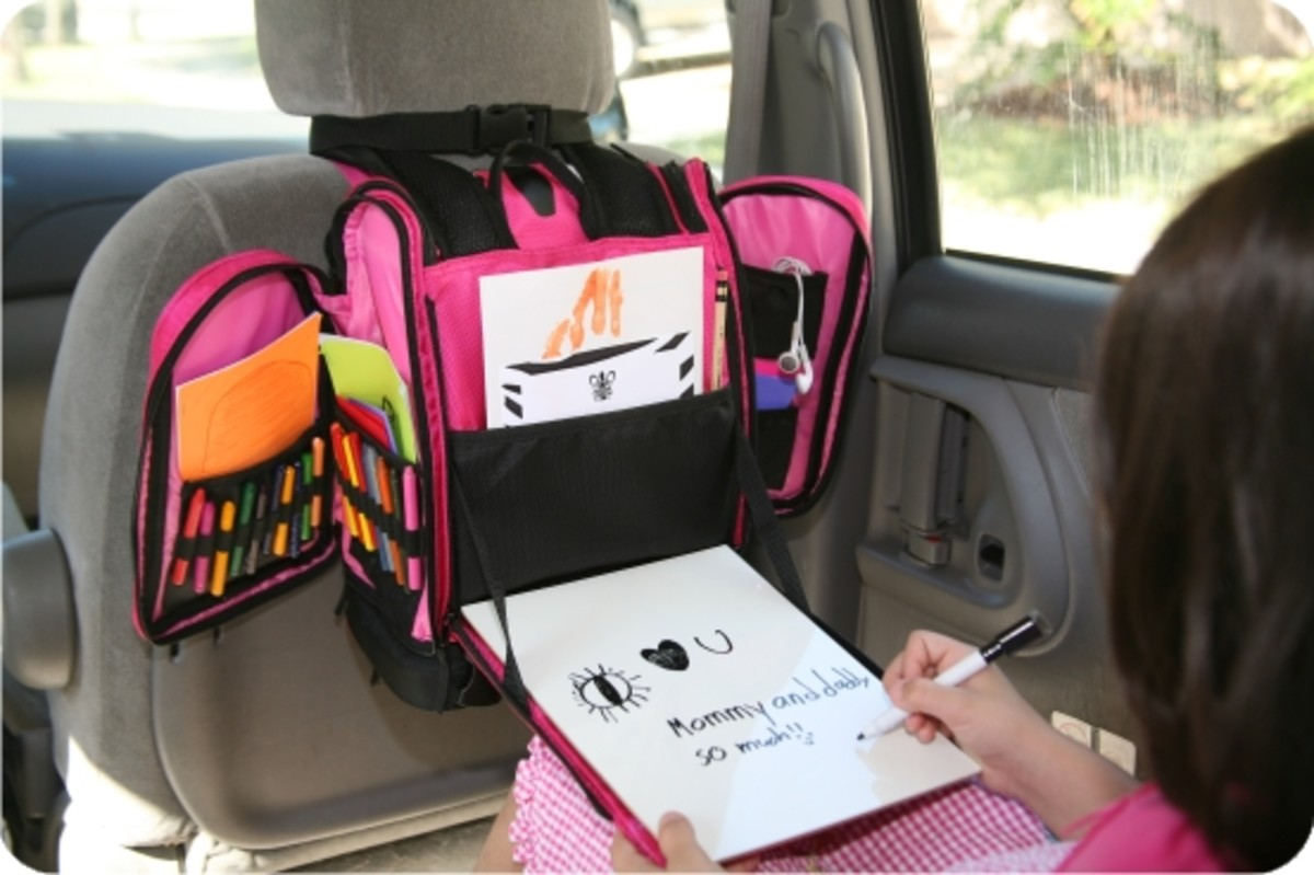 in the car they can also use the built in dry erase activity table that folds down and serves as a sturdy and mobile space to write read create