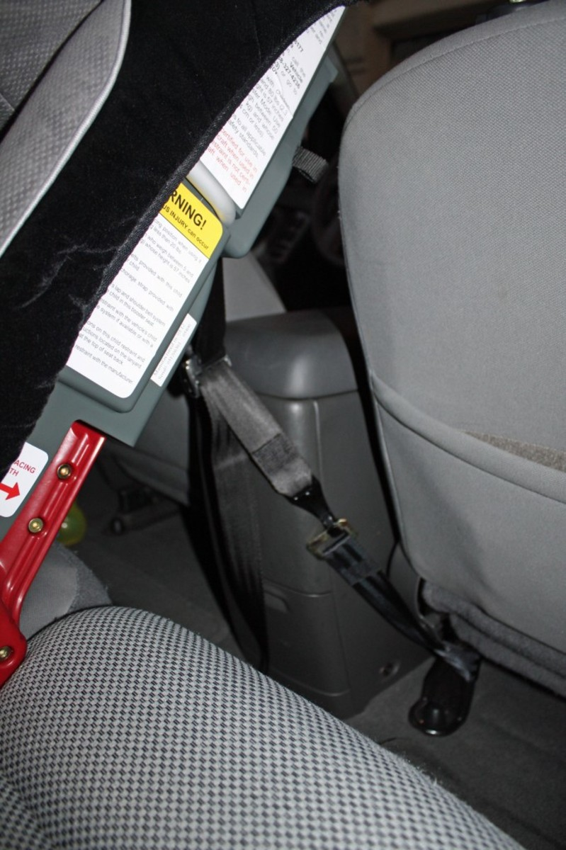 The rear-facing tether in action. The car seat feels very securely installed with the tether in place.