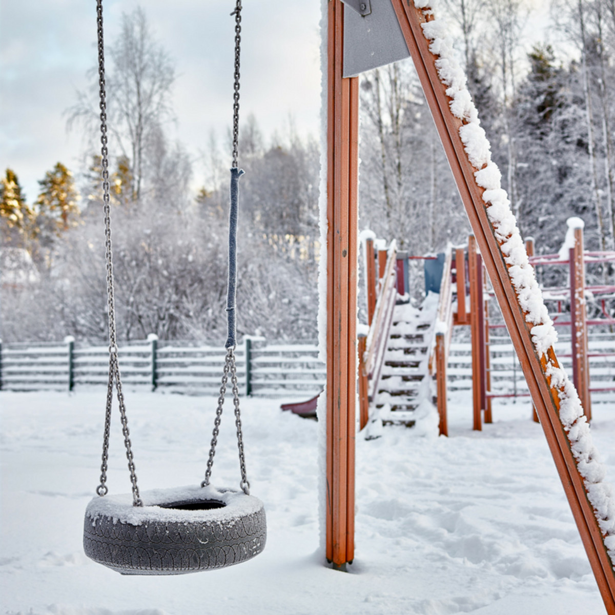 snowy playgound tire swing