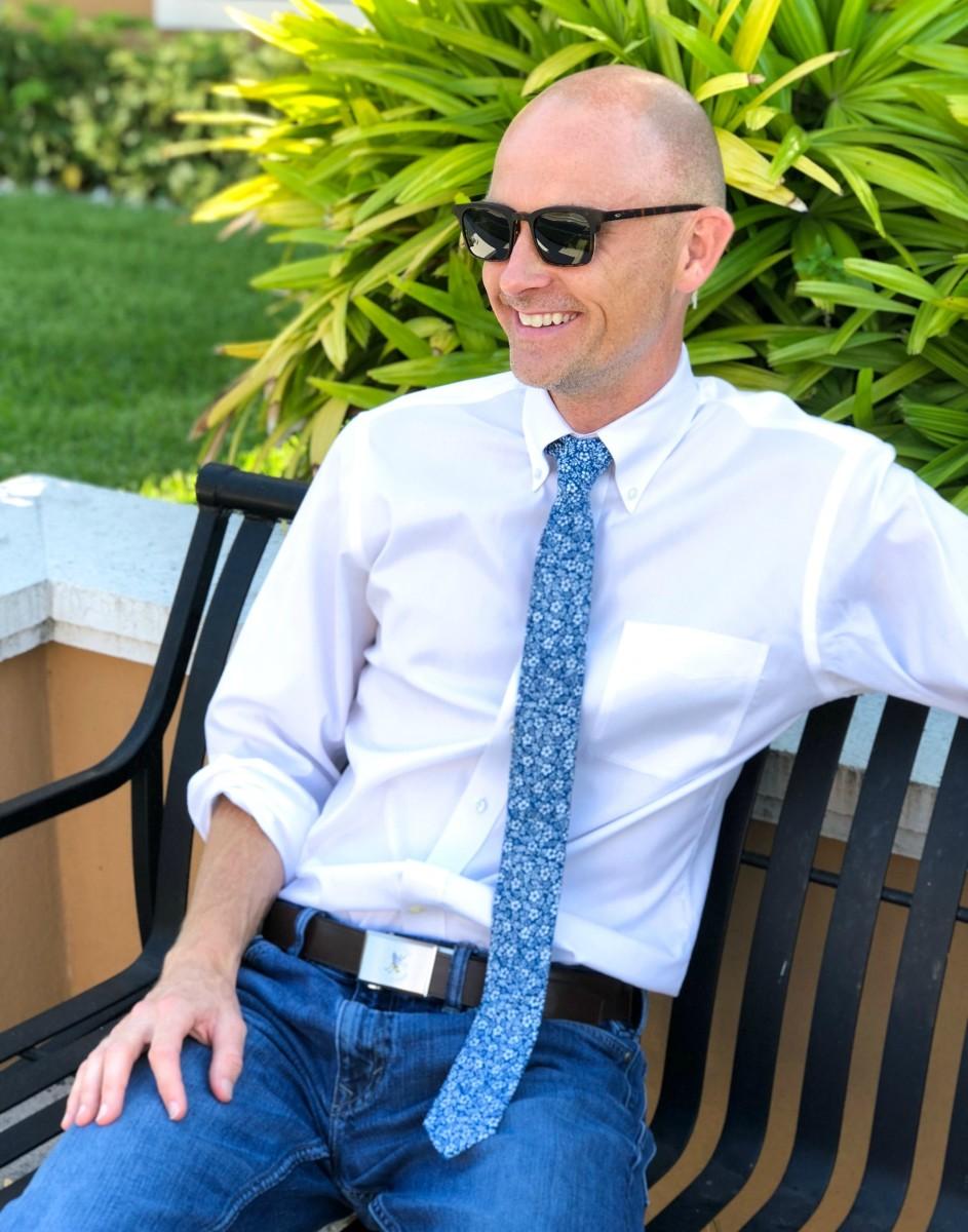 man wearing floral print tie