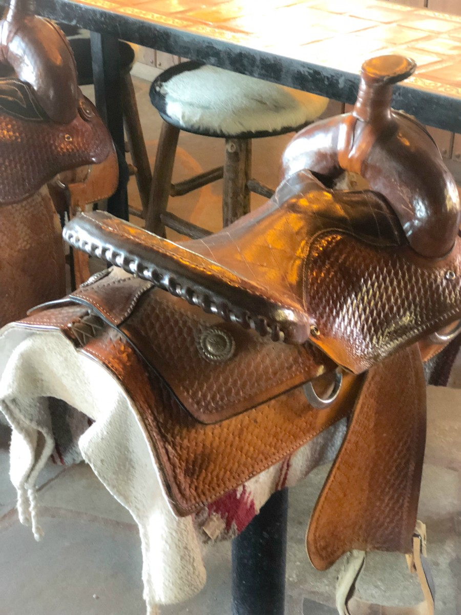 saddle bar stool at a dude ranch