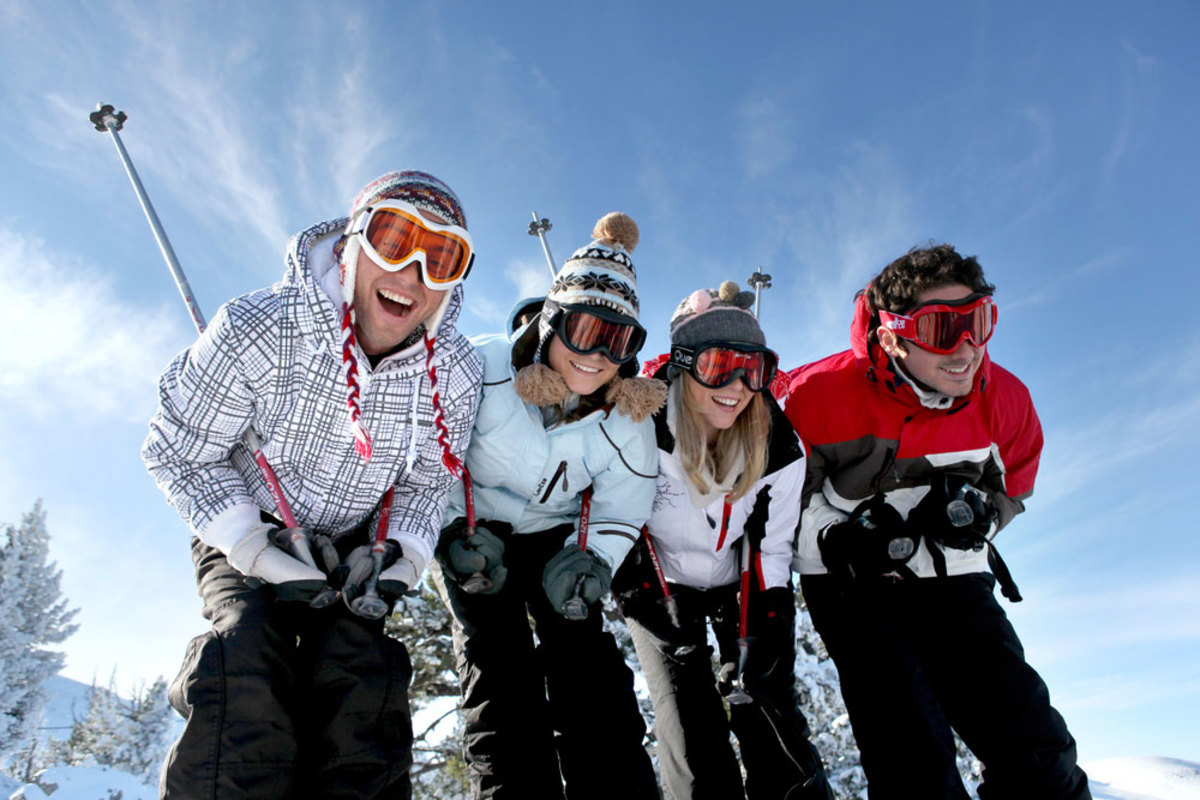 4-teens-smiling-ski-slopes