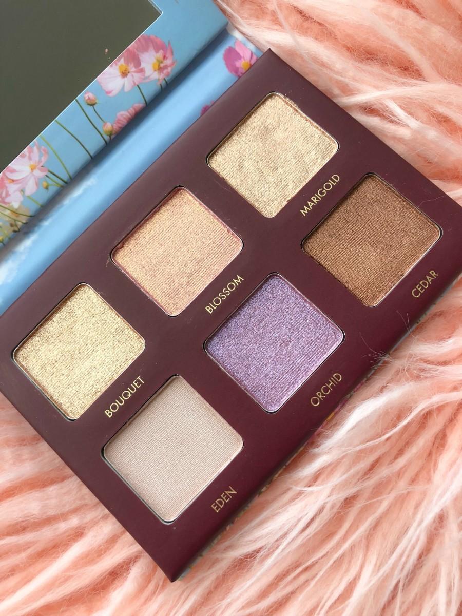 metallic eyeshadow palette on peach faux fur rug