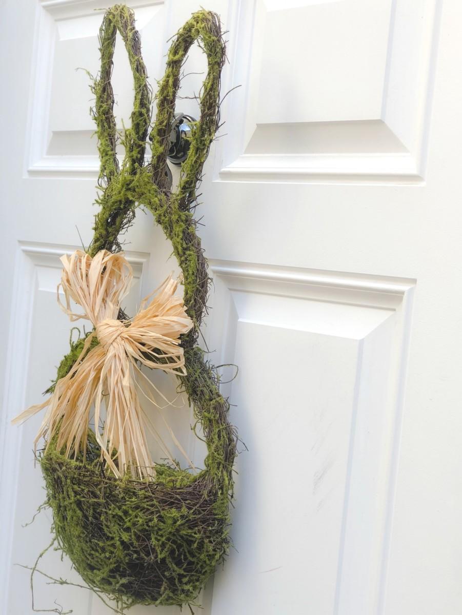 moss rabbit door hanging on white door