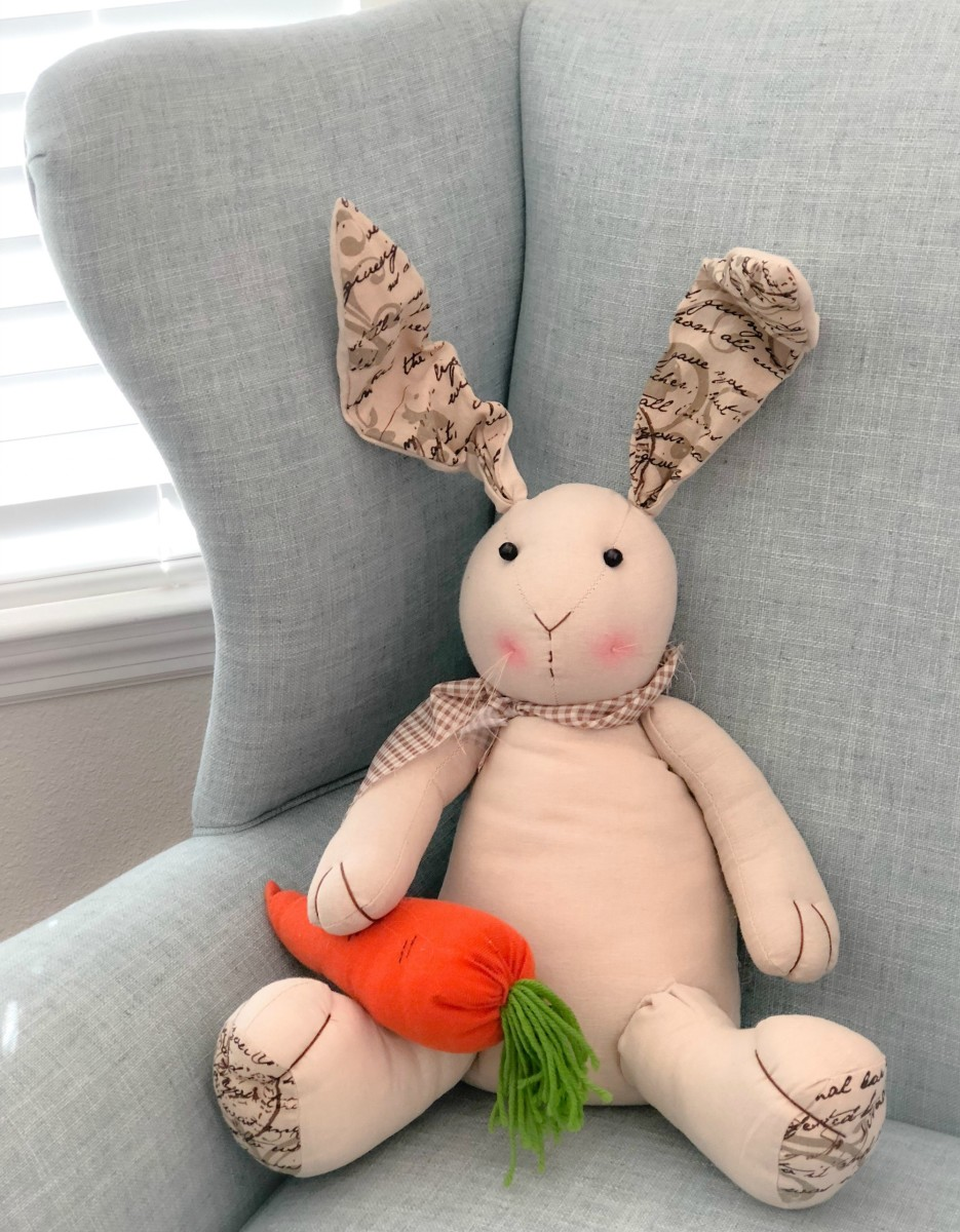 stuffed rabbit sitting in blue armchair