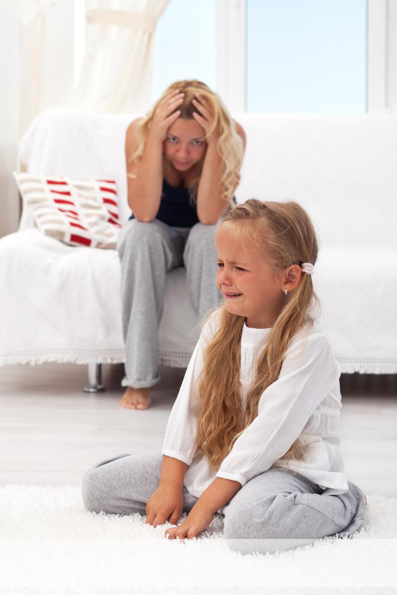 child having tantrum; frustrated mom