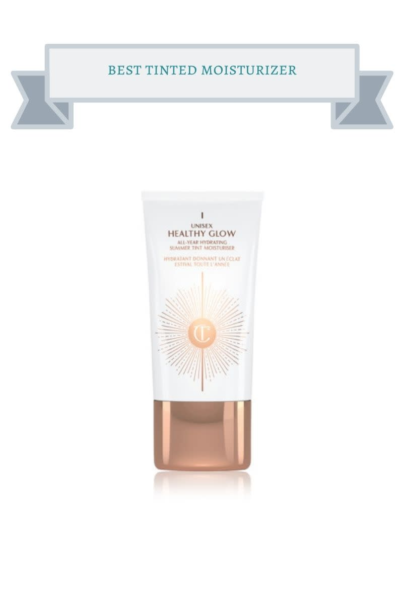 white bottle of Unisex Healthy glow tinted moisturizer with orange letting