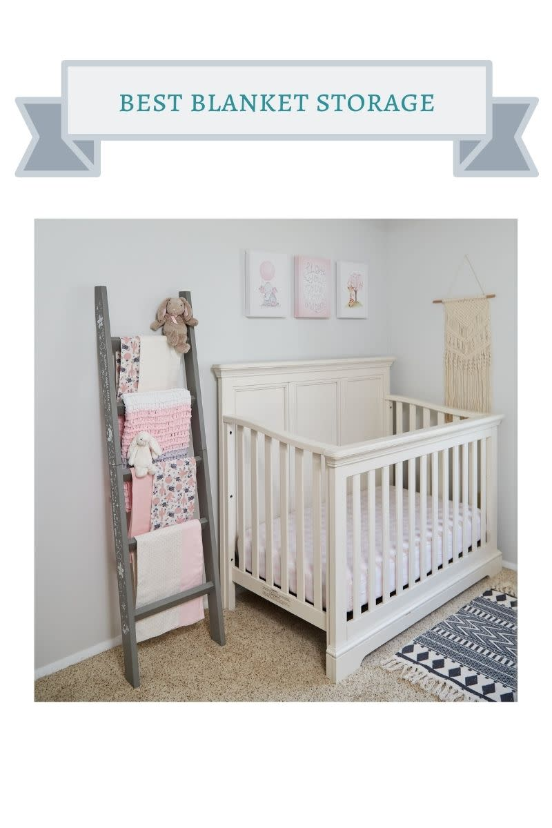 gray blanket ladder next to white crib