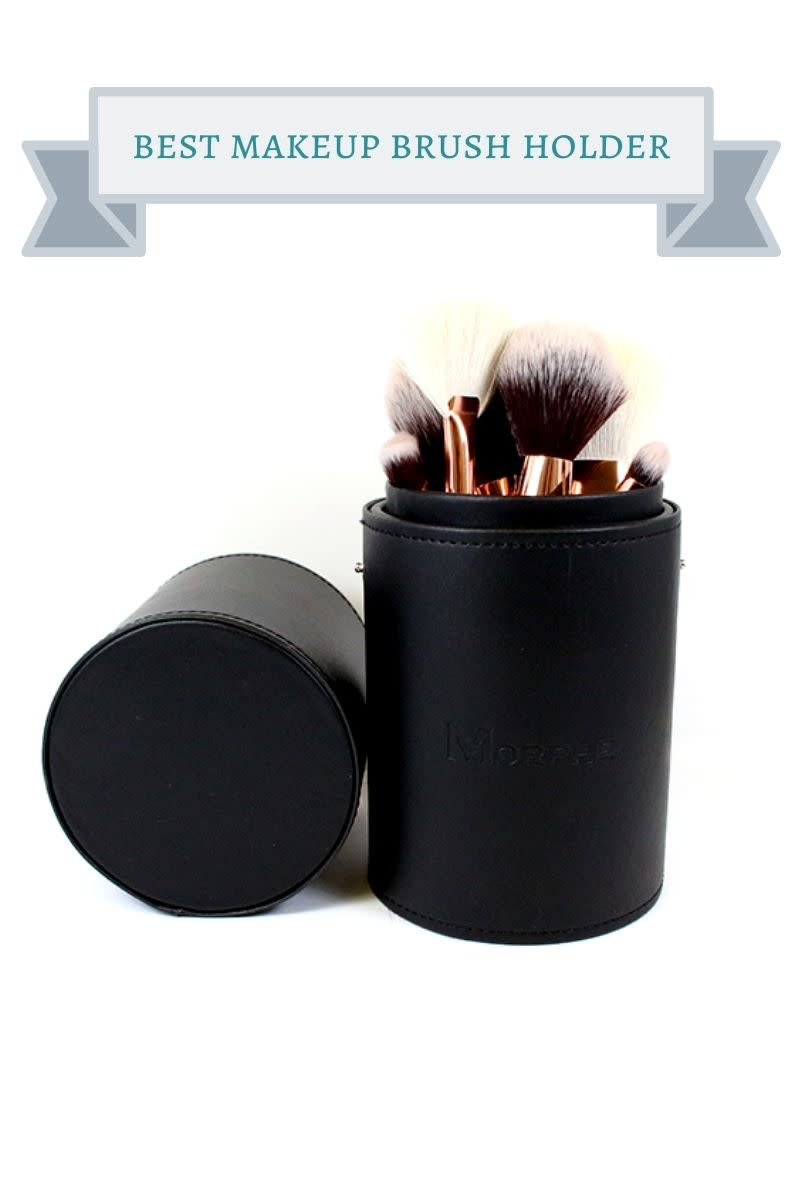black makeup brush cup filled with gold makeup brushes