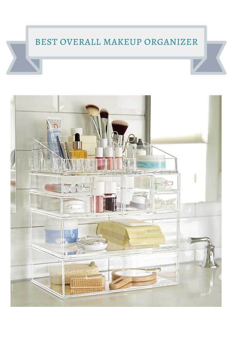 tall acrylic makeup organizer with makeup products on it