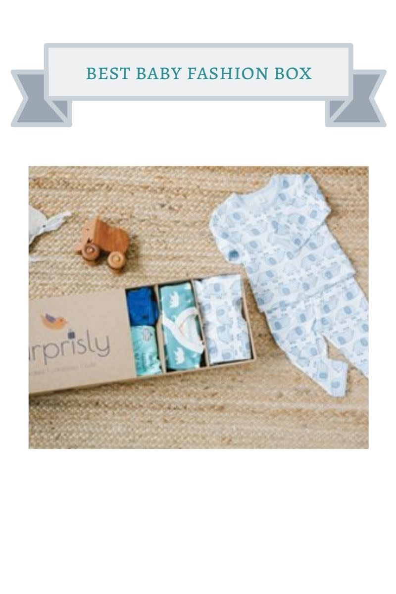 box filled with baby outfits like a white and blue sleeper