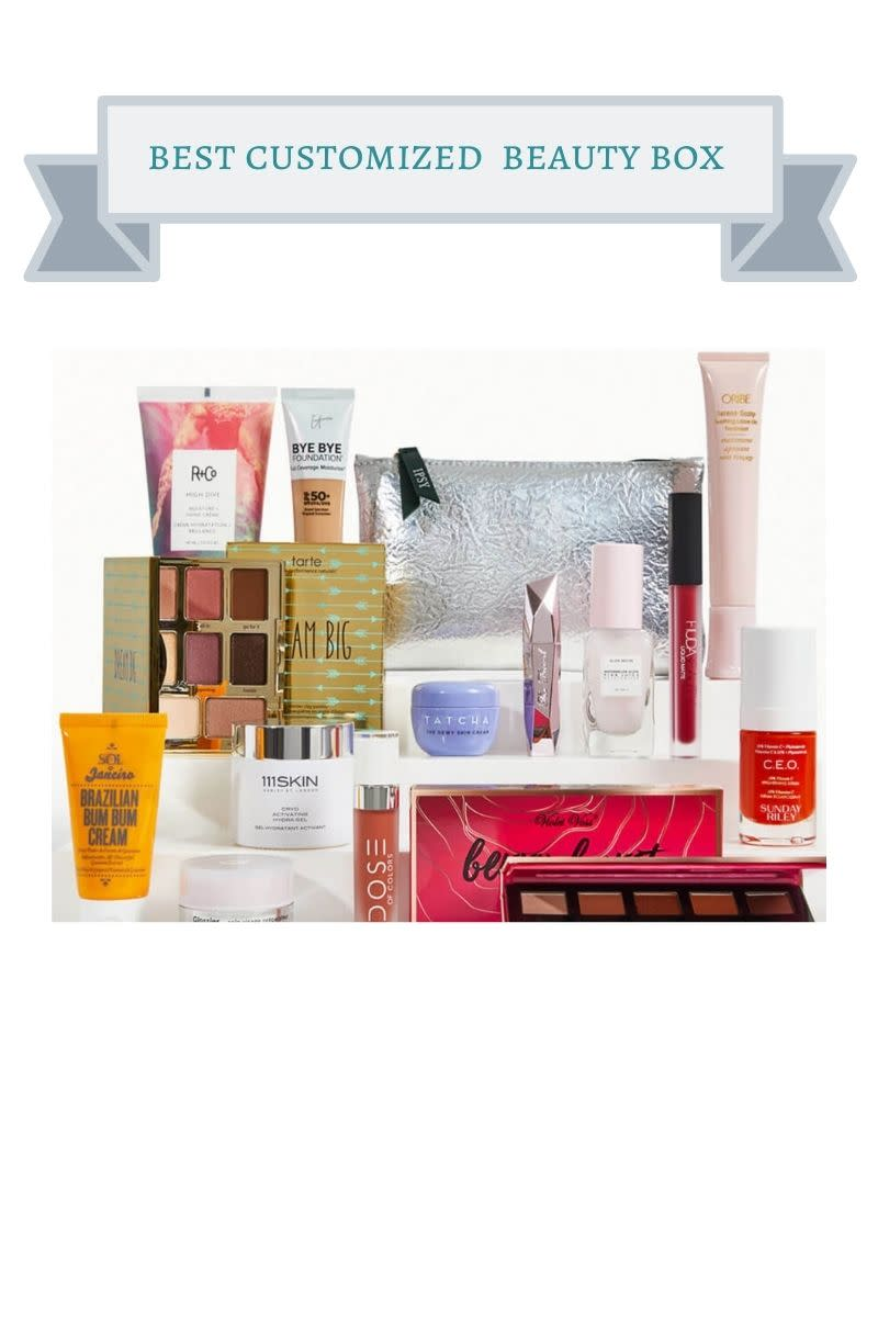 a silver makeup bag with a multi colored bottles, makeup palettes, lipgloss, mascara and more